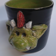 Mug with Fungus the bogeyman's son Mould, moulded on the side.