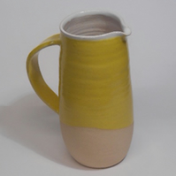 Sun yellow wheel thrown Jug.