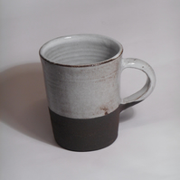 Wheel thrown black clay Texas Tea mug.