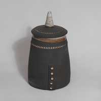 Black clay Stoneware lidded pot.