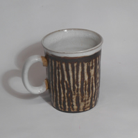 Stoneware Ceramic striped Mug.