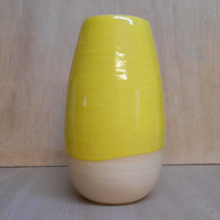 Yellow striped wheel thrown stoneware ceramic vase.