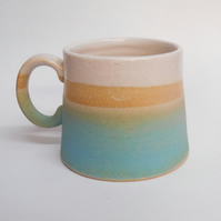 Wheel thrown Stoneware Turquoise blue tapered Mug.