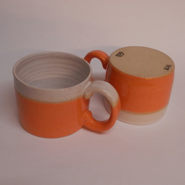 Set of Two Orange Banded Stoneware Cups.