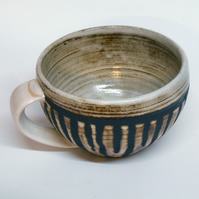 Wheel thrown black clay Striped Huggable Hot chocolate Mug.