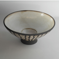 Black clay stemmed striped bowl.