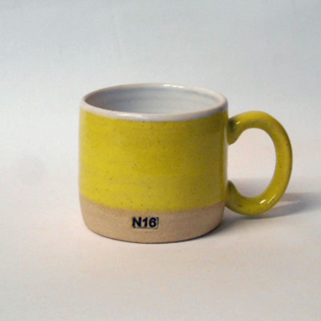 Wheel thrown smaller Sun Yellow stripe N16 mug.