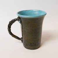 Elegant Turquoise Blue Black clay Mug.