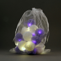 20 pom-pomfairy lights in white and lilac .
