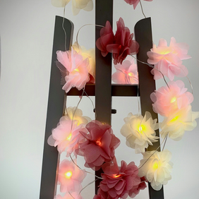 20 chiffon flower Fairy Lights in dusky pink, baby pink and cream.