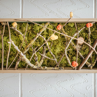Wall art with preserved moss and reclaimed wood.