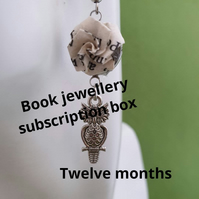 Unique jewellery subscription box for book lovers. Recycled paper origami jewell