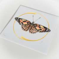 Fine art print of a painted lady butterfly with real gold decoration.