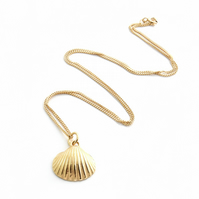 Gold plated seashell pendant on an adjustable chain.