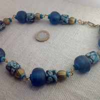 Necklace with giant recycled bottle glass and brass beads from Africa and Nepal