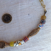 Necklace with West African recycled brass and glass beads and one from Nepal