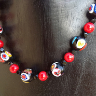 Bead necklace with Murano glass vintage millefori beads in black and red