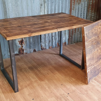 extending dining table with loop style welded steel legs and matching bench