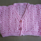 Cropped pink cardigan for babies