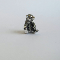 Tiny polar bear cub sitting, solid sterling silver