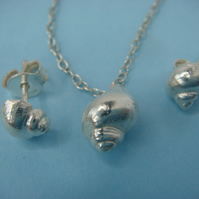 Tiny seashell stud earrings and pendant made from fine silver with a silver trac