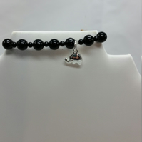 Stretchy Bracelet with Black Agate and silver plated elephant charm