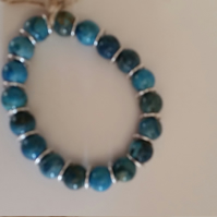Stretchy Bracelet with Blue Agate and Silver Jump Rings