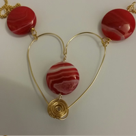 Necklace using Hand Shaped Heart and Red Striped Agate Puffy Coins