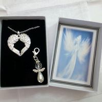 In the Arms of Angels Necklace Silver Plated Double Wings on silver plated trace