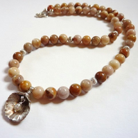 Shell with pearl necklace