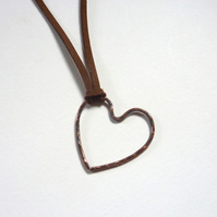 Oxidised Copper Heart Pendant With Hammered Texture on Brown Microfiber Cord