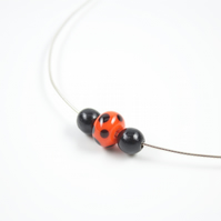 Handmade Lampwork Glass Focal Bead and Wooden Beads on a Sterling Silver Necklet