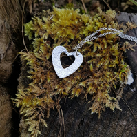 Sterling silver hammered heart necklace.