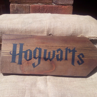 "Fantastic rustic style wooden ""HOGWARTS"" arrow shaped sign. Great gift idea."