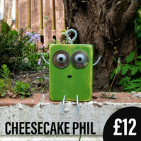 Cheesecake Phil - Scraplet, wood robot, wood mascot, desk buddy, office toy