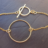 Gold Vermeil Circle Bracelet with a Gold Vermeil Toggle Clasp and Shocking Pink