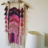 Woven macrame wall hanging in pinks and purples