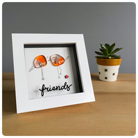 Friends picture featuring two fused glass birds in orange and pink tones