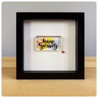 Keep Going glass art in a box frame with a fused glass panel in rainbow colours