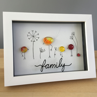 Family picture with handmade yellow and orange glass birds & hand drawn flowers