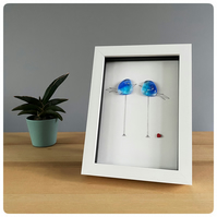 Blue birds picture in a box frame featuring two tall handmade fused glass birds