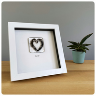 Glass heart picture with a glass tile with a black heart and silver sparkles