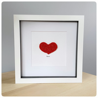 Love picture featuring textured red glass heart with the word 'love' beneath