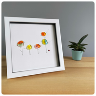 Group of five brightly coloured fused glass birds picture in a box frame