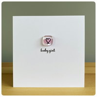 Baby girl new baby card with fused glass tile in light pink with a heart