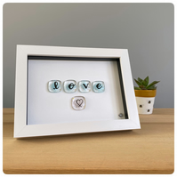 Love picture featuring hand lettered fused glass tiles in pale blue with a heart