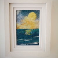 Needle felted framed picture of a sunset over water, with free motion embroidery