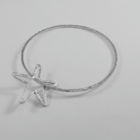 Sterling silver bangle with wire star