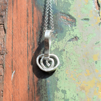 Sterling Silver, Spiral Pendant with a delicate and organic surface texture