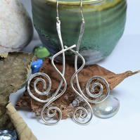 Solid Sterling Silver - statement earrings with a spiral design